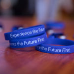"Fairway wrist bands that read, ""Experience the Future"""